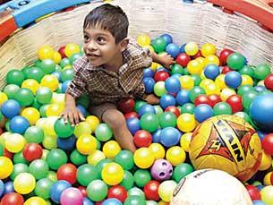 boy-playing-in-balls-basket