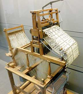 The Jacquard Loom inspired the use of punched cards.