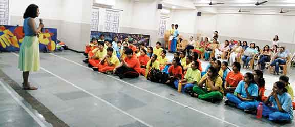 Students-and-parents-listening-intently-to-Ms-Ishita-Manek