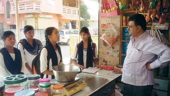 students-talking-to-shopkeeper